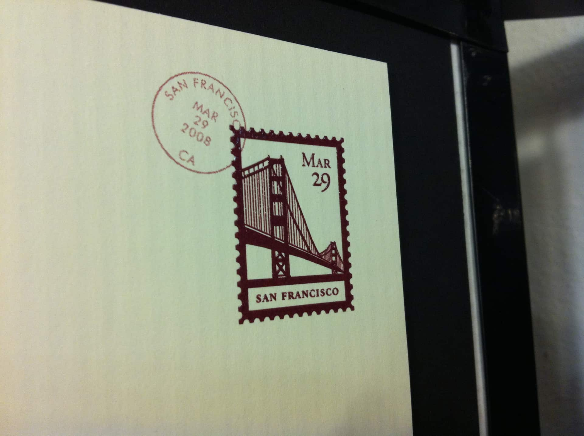 Save the Dates printed in thermography with golden gate bridge stamp icaon