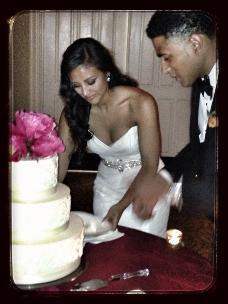 pamela_and_devin_cutting_wedding_cake