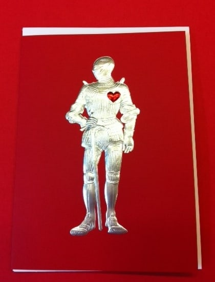 This dashing Knight has a red foil heart!