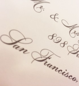 digital/computer calligraphy used to address guest names on holiday card envelopes
